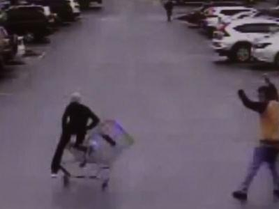 CAUGHT ON CAM: Walmart customer throws cart into shoplifter to help police