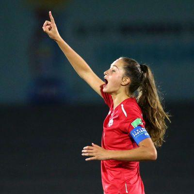 Canada edge Germany to book last-four spot