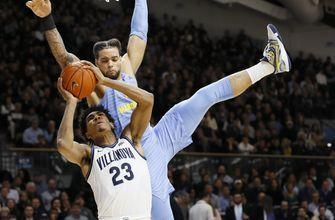 Robinson-Earl leads No. 15 Villanova past No. 18 Marquette