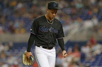 Marlins can't hold off late rally by Nationals, fall 10-4 in extras