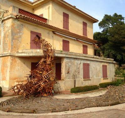 Masses of Wooden Chairs Pour From Old Villas by Karin van der Molen