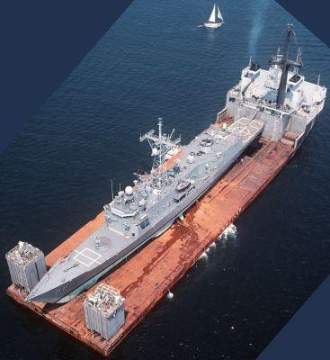 These are the massive ships the Navy uses to carry other ships around
