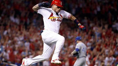 Rally cat: Molina slam after cat runs on field leads Cards over Royals