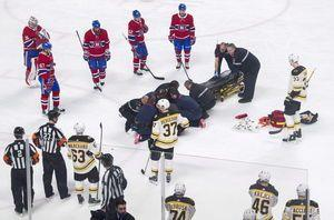 Bruins beat Canadiens 4-3 after Danault hit by Chara shot