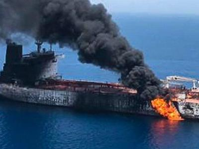 Photos and video show flames, ash, and charring on oil tanker allegedly hit by torpedo in Gulf of Oman