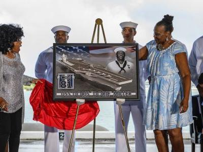 The Navy's newest aircraft carrier is being named in honor of an African American hero at Pearl Harbor
