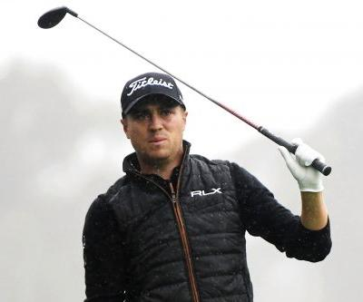 Justin Thomas tied for lead at rainy Riviera, Tiger Woods nine back