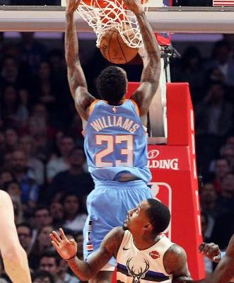 Clippers rally to beat Bucks 105-98, improve playoff hopes