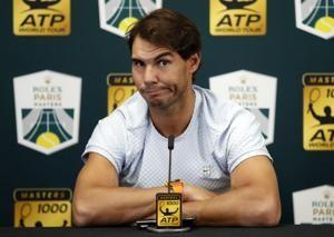 Rafael Nadal pulls out of Paris Masters with abdominal pain