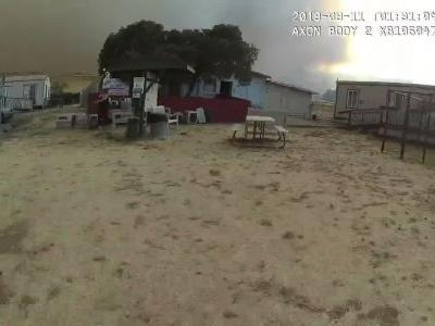 Caught on video: 60 dogs, cats saved by police in daring wildfire rescue
