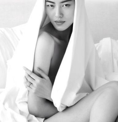 In the covers with Liu Wen.  Photograph by Mert Alas and Marcus