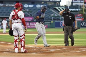 Marmolejos' first homer powers Mariners over Angels 8-5