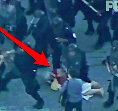 WATCH: Police officers walk over a lady during St. Louis protests