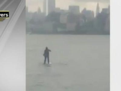 Video shows a guy paddle-boarding across the Hudson river in a suit so he didn't miss a meeting in NYC