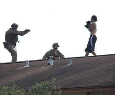 'They saved him to see another day:' Police arrest knife-wielding man on apartment roof