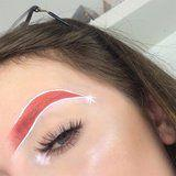 This Santa Hat Brow Trend Is All of Us at Midnight After Thanksgiving