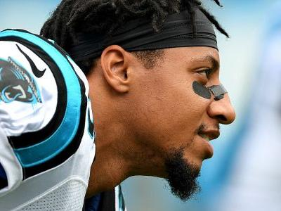 Panthers' Eric Reid held back by teammates after confrontation with Eagles' Malcolm Jenkins