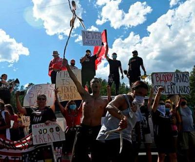 National Guard, law enforcement move to disperse people blocking road to Mount Rushmore