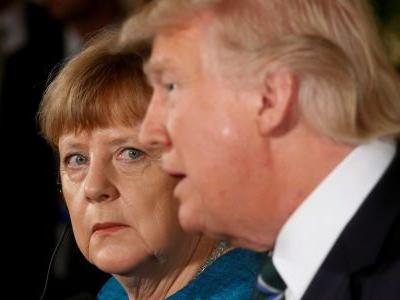 MERKEL WARNS: The EU will 'defend its interests' if Trump pushes tariffs