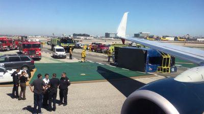 8 injured at LAX after passenger jet rams into truck on landing