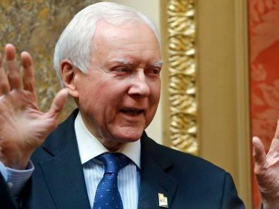 Video shows Republican Sen. Orrin Hatch waving off Kavanaugh protesters who confronted him in an elevator