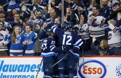 Newly acquired Hayes scores 1st goal with Jets in win over Preds
