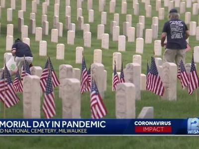 Couple puts flags on graves to pay tribute to veterans on Memorial Day