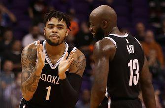 Russell has 23 points, 8 assists; Nets beat Suns 98-92