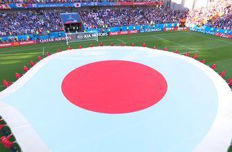 Watch Japan fans and players sing their national anthem