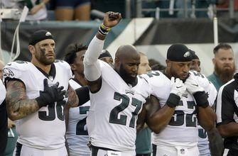 Chris Long supports Malcolm Jenkins during anthem protest