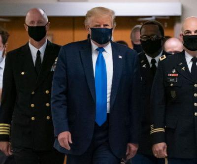 After Months of Refusing to Wear a Mask, Trump Finally Dons One to Visit Walter Reed Hospital