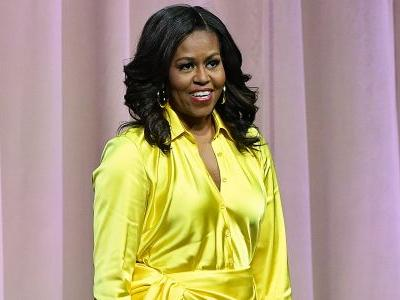 Michelle Obama Looks Like A Real-Life Super Hero In Fab Thigh-High Boots