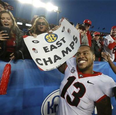 No. 6 Georgia tops No. 11 Kentucky 34-17 to clinch SEC East