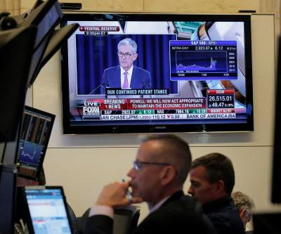 Wall Street is certain the Fed will slash interest rates next month. But a key official says that will only happen if the coronavirus becomes a pandemic