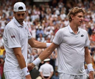 Anderson, Isner demand change after epic as Nadal and Djokovic halted