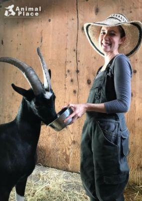 Animal Place's Rescue Ranch caregiver Ariel and Lucas the goat