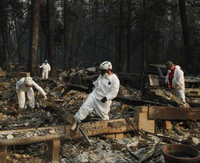 Searchers in California fires step up efforts ahead of rain