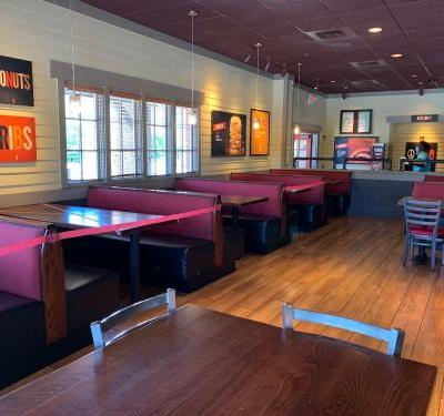 An exclusive first look at the strange new normal of dining out in Georgia as BBQ chain Smokey Bones reopens dining rooms in the state