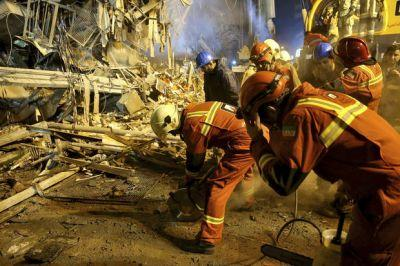 Rescuers searching for victims of Iran building collapse