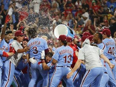 Harper hits grand slam in 9th, Phillies rally past Cubs 7-5