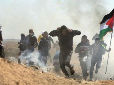 Dozens of Palestinians armed with slingshots and setting tire fires have been killed in violent protests on the Israel-Gaza border