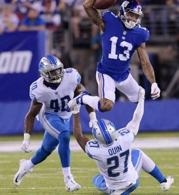 Stafford throws 2 TDs to Lions beat Giants and Beckham