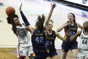 No. 1 UConn ends regular season by beating Marquette 63-53