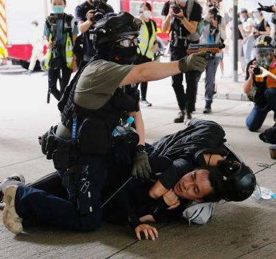 Hong Kong police are arresting people who defied authorities to protest after China imposed a sweeping new national security law