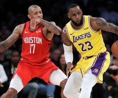 LeBron James turns it on late as Lakers roll past Rockets