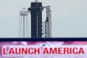 2 U.S. astronauts suit up for historic SpaceX launch