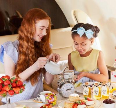 A private-jet company is offering 'Alice in Wonderland' tea parties at 45,000 feet for ultrarich kids