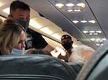 Easyjet passenger refusing to wear mask slapped by wife as foul-mouthed tirade sparks mass bust-up