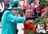 Queen Elizabeth II Spreads Cheer as She Decorates a Christmas Tree at a Children's Charity