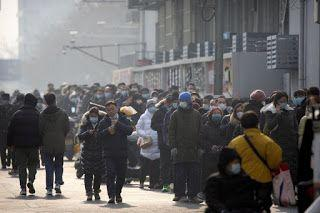 Long lines as Beijing expands mass COVID testing